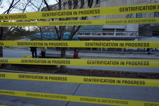 """Gentrification in progress"" tape at the ""Double Crossing Brooklyn"" protest outside the Brooklyn Museum (Jillian Steinhauer for Hyperallergic). http://goo.gl/G7U9P9"